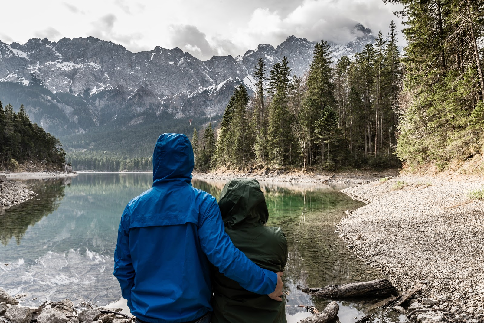 Two people at a mountain lake